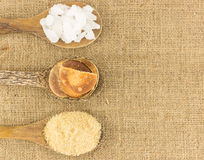 Top view of  sugar  on brown texture Stock Photos