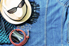 Top view of summer accessories for modern woman on denim jean ba Stock Images