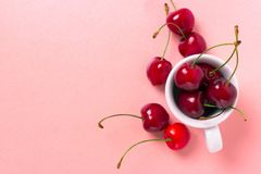 Sweet cherry in the white cup royalty free stock photo