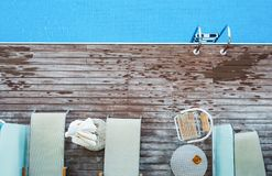 A top view of sunbathing deck and private swimming pool near beach, summer holiday concept. Copy space stock photography
