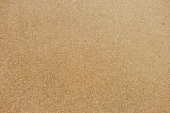 Top view of surface of clean golden sand at sea beach. Horizontal color photography stock photo