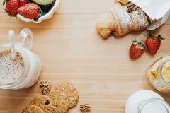 Top view of sweet breakfast with Coffee, milk, cookies, croissan Stock Photos