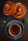 Top view of sweet buns with cup of tea Royalty Free Stock Images