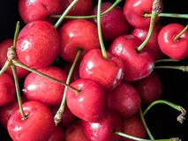 Top view on sweet cherry fruits on black background stock photo