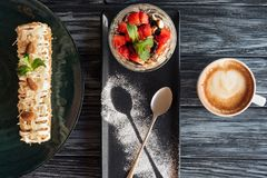 top view of sweet gourmet desserts and cup of coffee stock image