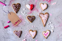 Sweet heart shaped cookies with love tag on grey cracked surface. Top view of sweet heart shaped cookies with love tag on grey cracked surface Royalty Free Stock Photos