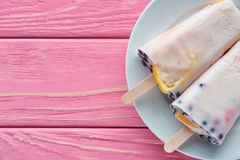 Top view of sweet tasty homemade ice cream on plate on pink wooden. Table stock photography