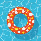 Top view Swim ring icon on the blue water background. Stock Image