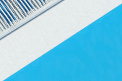 Top view of a swimming pool with blue deck chairs. Top view of a swimming pool. White floor with blue deck chairs standing on it. Concept of relaxation and rest Stock Photography