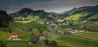 Top view of a Swiss village in a green valley. Stock Photos