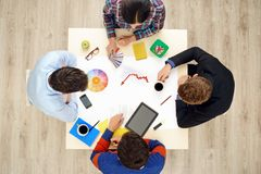 Top view table with creative people and gadgets Royalty Free Stock Photos
