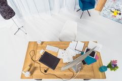 Top view of table of designer with fashion illustrations. And computer stock image