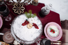 Top view of a table with dread and cookies baskets  candles, two chairs covered  white fur on the background. Picnic in the winter Royalty Free Stock Photography