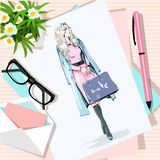 Top view of table with flowers, papers, sketch, pen, envelope. Paper with hand drawn fashion woman with bags. Vector illustration stock illustration