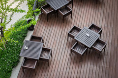Top view of table and four chairs on living terrace at cafe. Stock Photography