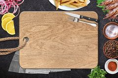 Top view of table top with fresh ingredients. Top view of chopping board and fresh ingredients for a healthy meal stock photo