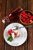 Top view on table with lemonade and cherry cake Royalty Free Stock Image