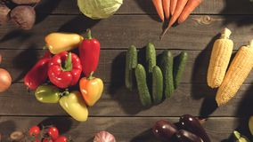 Top view of a table with a variety of vegetables. Close up. The smooth glide of the camera  from left to right  along the old village table with a variety of stock video footage