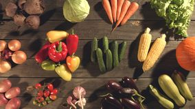 Top view of a table with a variety of vegetables. The smooth glide of the camera  from left to right  along the old village table with a variety of vegetables stock video footage