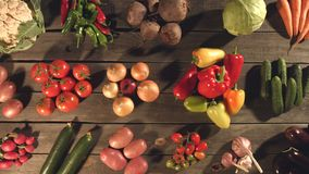 Top view of a table with a variety of vegetables. The smooth glide of the camera  from right to left  along the old village table with a variety of vegetables stock video footage