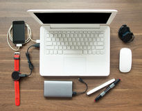 Top View Table Workspace With Laptop And Smart Watch Stock Image