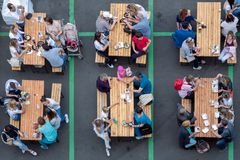 People eating fast food. Top view of the tables with people eating fast food royalty free stock photo