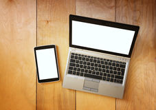 Top view of tablet device and laptop with blank screen ready for mock up. filtered image Royalty Free Stock Photo