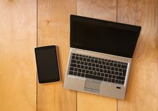 Top view of tablet device and laptop with blank screen ready for mock up. filtered image Royalty Free Stock Images
