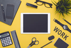 Top view tablet hero header. Top view office desk tablet hero header with yellow background and black office items around Royalty Free Stock Photography