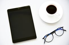 Top view tablet,pen,glasses and Laptop royalty free stock image