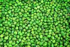 Top view tasty crispy green sugar pea with salted texture on background , deep fried until golden stock images