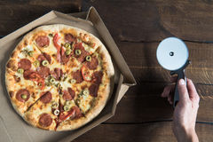 Top view of tasty fresh pizza in cardboard box Stock Photo