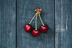 top view of tasty healthy red cherries on rustic royalty free stock photo