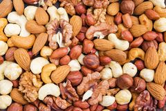 Top view of tasty mix nuts background. Concept healthy snack. Top view of tasty mix nuts background. Concept healthy snack stock photos