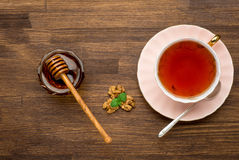 Top view of tea honey and nuts with mint on wooden Royalty Free Stock Photos