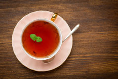 Top view of tea with mint on wooden background Stock Photos