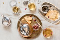 Top view of tea set and biscuits stock image