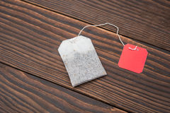 Top view teabag with blank tag on wood Royalty Free Stock Photography