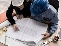 Top view teamwork concept, Engineer and workers discussing project of new building. ,Team of architects Asian people in group on. Construction site check royalty free stock photo