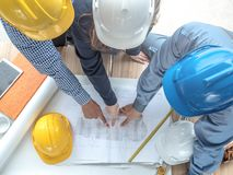 Top view teamwork concept, Engineer and workers discussing project of new building. ,Team of architects Asian people in group on. Construction site check stock photography