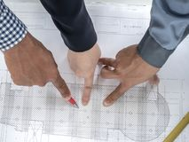 Top view teamwork concept, Engineer and workers discussing project of new building. ,Team of architects Asian people in group on. Construction site check stock photo