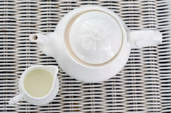 Top view of Teapot with little milk jar Stock Photo