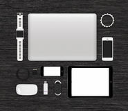 Top view of tech gadgets mock up for branding identity on black Stock Photography