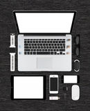 Top view of tech mock up consisting laptop, tablet pc, smartphon Royalty Free Stock Images