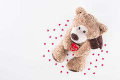 Top view of teddy bear with heart shaped gift box and paper hearts. Isolated on white Royalty Free Stock Photography