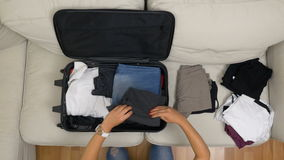 Top view of teenage girl with red polished nails preparing travel bag for the summer trip. Top view of teenage girl with red polished nails preparing travel bag stock video