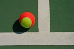 Top view of tennis ball and white line Royalty Free Stock Photos