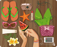 Top view with textured table and summer set, swimsuit, starfish, camera Stock Photos