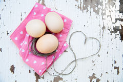 Top view of three eggs on rose napkin Royalty Free Stock Image
