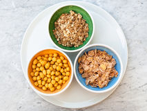 Top view of three kind of cold breakfast cereals. In bowls on white plate Stock Photos